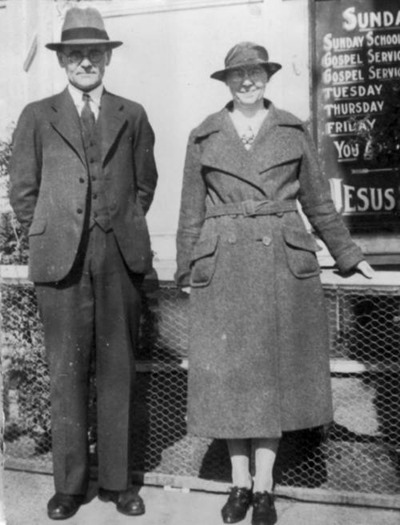 Mr. and Mrs. Edwardson in front of the First Mission