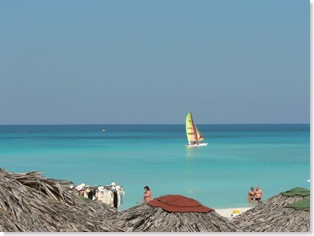 Beach and sailboat