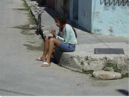 girl sits on sidewalk
